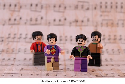 Colorado, USA - March 20, 2017: Studio shot of Lego minifigure Beatles John, Paul, George, and Ringo surrounded by music notes.