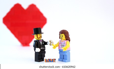 Colorado, USA - March 20, 2017: Studio shot of Lego minifigure man and woman in love with heart in background. Image isolated on white.