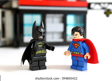Colorado, USA - March 22, 2015: Studio shot of Lego minifigure Batman and Superman with building in background, image isolated on white.