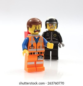 Colorado, USA - March 25, 2015: Studio shot of Lego minifigure Emmet and Bad Cop. Legos are a popular line of plastic construction toys manufactured by The Lego Group, a company based in Denmark.