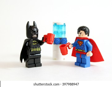 Colorado, USA - March 25, 2016: Studio shot of LEGO minifigure Batman and Superman standing by a water cooler with drinks.