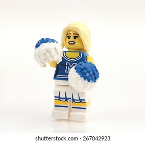 Colorado, USA - March 29, 2015: Studio shot of Lego cheerleader. Legos are a popular line of plastic construction toys manufactured by The Lego Group, a company based in Denmark.