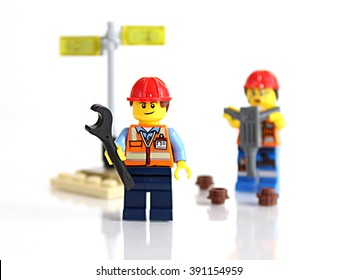Colorado, USA - March 9, 2016: Studio shot of LEGO minifigure construction workers with tools, isolated on white background.