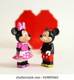 Colorado, USA - May 13, 2016: Studio shot of LEGO minifigure Mickey Mouse and Minnie Mouse in love with heart in background.