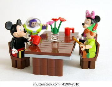 Colorado, USA - May 13, 2016: Studio shot of LEGO minifigure Mickey Mouse. Peter Pan, Buzz Lightyear, and Minnie Mouse all sitting at a table together.