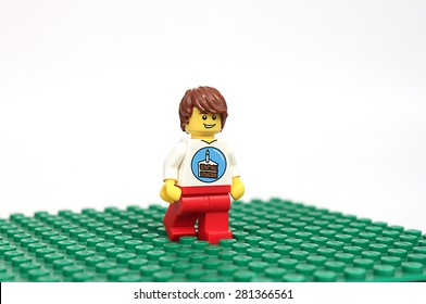 Colorado, USA - May 18, 2015: Studio shot of Lego minifigure birthday guy. Legos are a popular line of plastic construction toys manufactured by The Lego Group, a company based in Denmark.