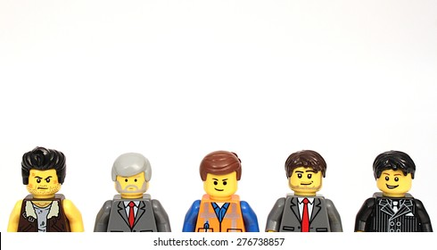 Colorado, USA - May 8, 2015: Studio shot of Lego men with text space above. Legos are a popular line of plastic construction toys manufactured by The Lego Group, a company based in Denmark.