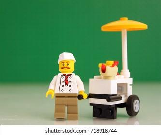 Colorado, USA - September 19, 2017: Studio shot of LEGO businessman hot dog seller green LEGO baseplate background.