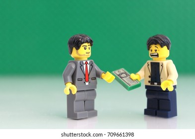 Colorado, USA - September 5, 2017: Studio shot of  LEGO businessman with scared look having to deal with money.