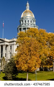 Colorado USA State Capitol Building in Denver, CO on sunny autumn morning with changing tree around building