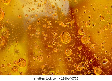 Colored abstract background consisting of oil bubbles and drops. Macro