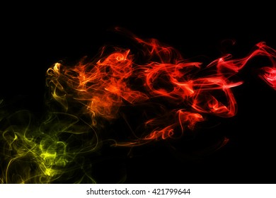 Colored abstract smoke, isolated on black background. Photo. Acid neon color.