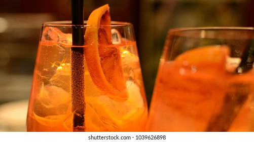 Colored alcohol aperitif with lemon