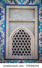 Colored arabic decorations close up on a wall.