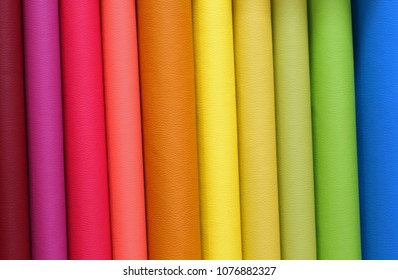 colored background of many pieces of tanned leather for sale in the tannery specializing in industrial dyeing