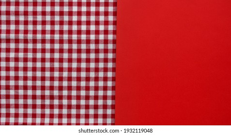 Colored background. Red checkered tablecloth and red background.