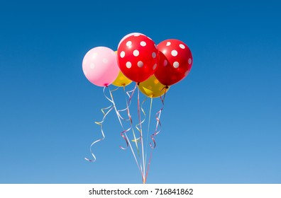colored balloons against the blue sky