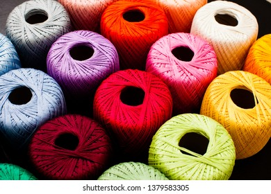 Colored balls of yarn close up, rainbow palette