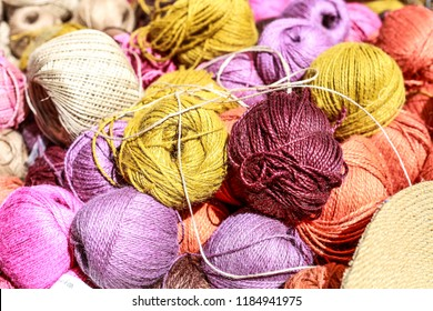 Colored balls of yarn. Knit yarn for knitting. Skeins of fabric.