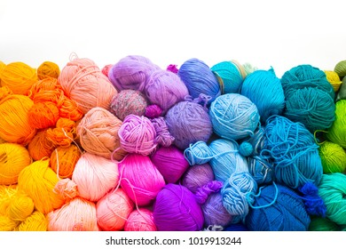 Colored balls of yarn. Knitting needles. Crocheting yarn