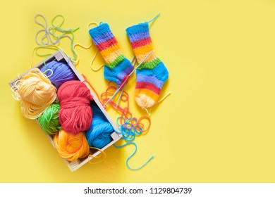 Colored balls of yarn. Rainbow colors. All colors. Yarn for knitting. Skeins of yarn.