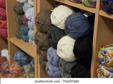colored balls of yarn or wool in a shop
