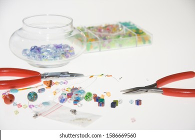 Colored beads and tools for making jewelry