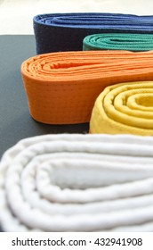 colored belts for martial arts, yellow orange green blue for judo, karate and others sports