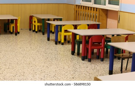 colored benches and plastic chairs of a classroom of a preschool without children