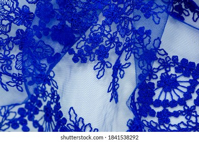 Colored blue lace fabric. Vintage. Flowers background in Provence style. Decorative ornament background for fabric, textile, wrapping paper, cards, invitations, wallpaper, web design.