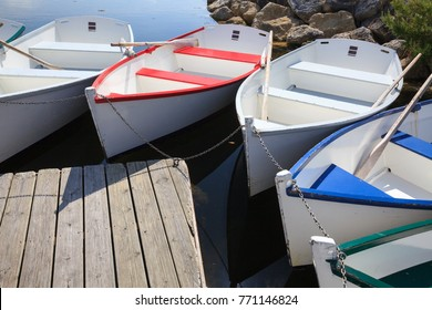 colored boats at pier