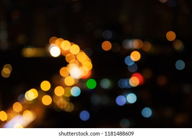 Colored bokeh lights on black background