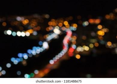 Colored bokeh lights on black background