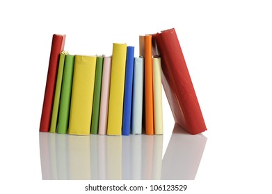 colored books in a row. Isolated on white background