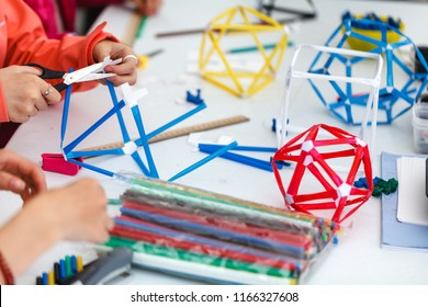 Colored boxes with paper strips, inventions and creativity for children. educational activities for schools and children kid