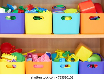 Colored boxes with various toys.