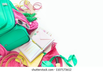 Colored bright things for rest and travel. Planning a vacation. Blue, turquoise, aquamarine, purple, lilac, pink, purple.