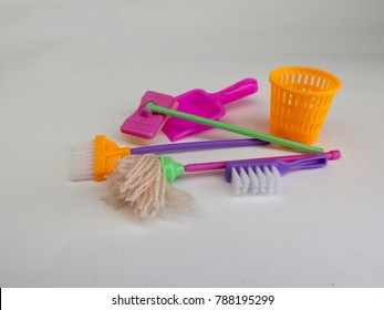 Colored brush, trash, MOP and broom on white background
