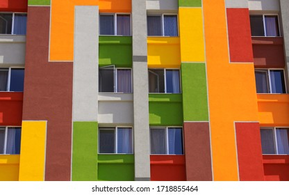 Colored building facade with apartment windows