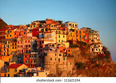 Colored buildings in Manarola town at sunset. Cinque Terre national park. Italy