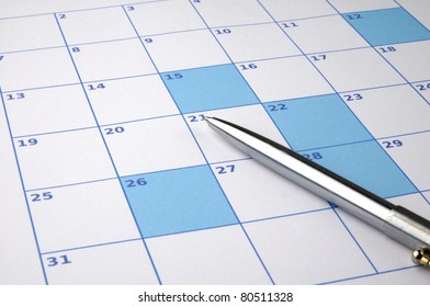 Colored calendar with highlighted dates and a pen