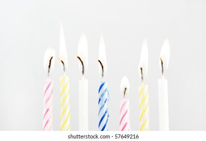 Colored candles on grey background
