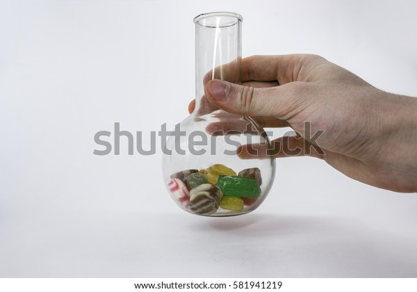 colored caramel sweets in glass vase, isolated on a white background