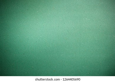 Colored cardboard background in green tone. Copy space.