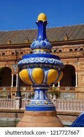 Colored ceramic decoration detail of architecture in Plaza de Espana in Seville, Spain