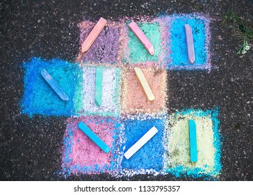 Colored chalk on a sidewalk  background, top view, soft focused