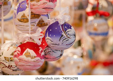 Colored Christmas globes painted with snow and homes