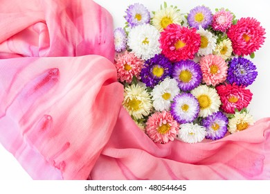 Colored chrysanthemums flowers background. Flat lay.