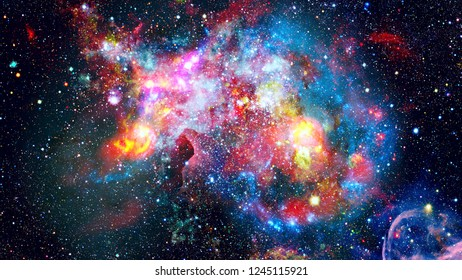 Colored clouds in nebula. Combined version of Hubble space telescope image. Elements of this image furnished by NASA.