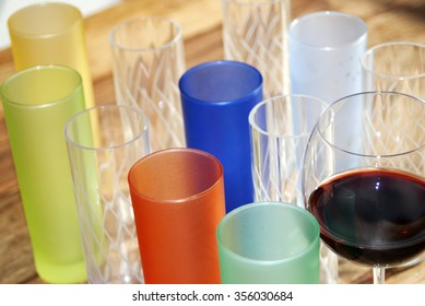 colored cocktail glasses on a table for a plays of light and colors